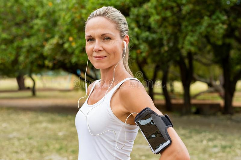 Mature woman jogging royalty free stock photography