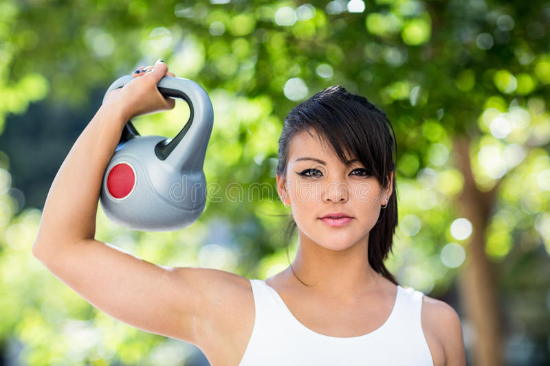 Portrait of athletic woman lifting kettlebell royalty free stock photos