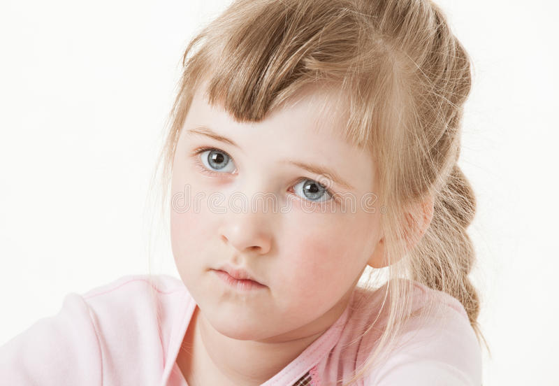 Portrait of a attentive pretty little girl. White background royalty free stock photo
