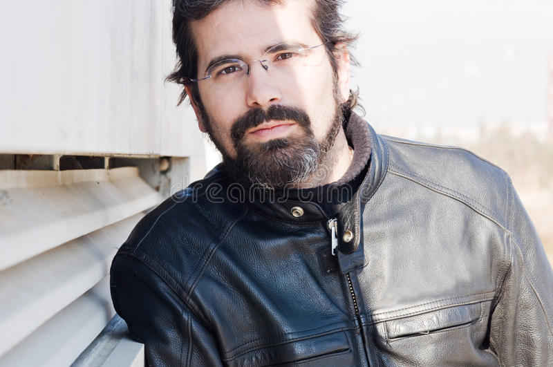 Portrait of attractive adult man with beard royalty free stock photography
