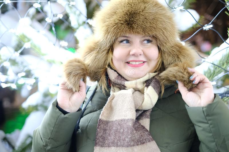 Portrait of attractive adult plus size model, smiling, winter, N. Ew Year or Christmas time, evening or night time stock photography