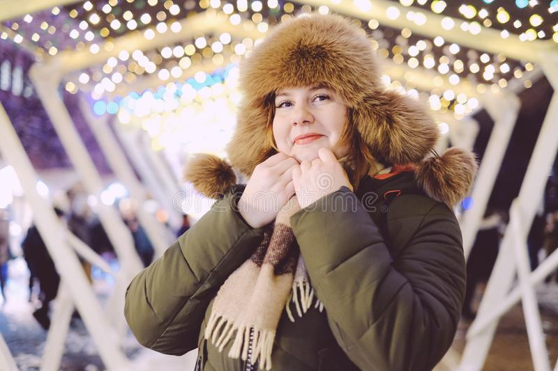 Portrait of attractive adult plus size model, smiling, winter, N. Ew Year or Christmas time, evening or night time stock photos