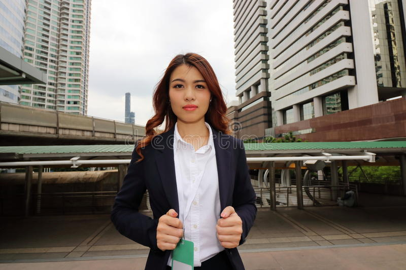 Portrait of attractive Asian business woman on the city background royalty free stock images