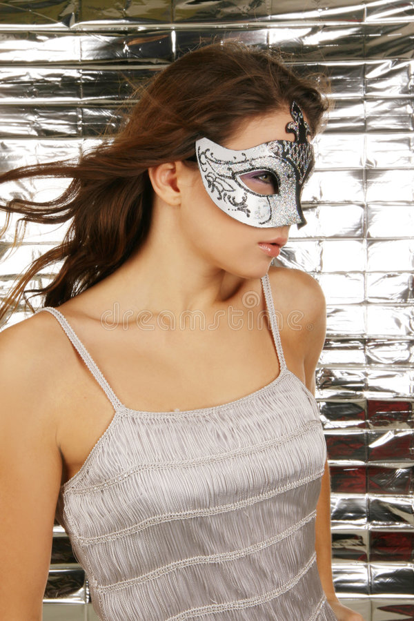 Portrait of attractive beautiful woman wearing sil. Ver carnival mask stock image