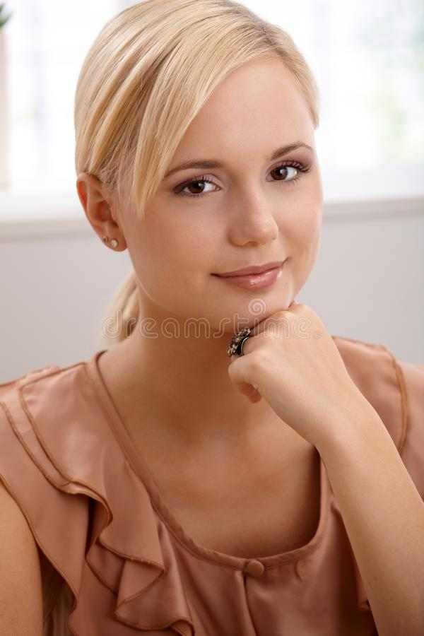 Portrait of attractive blond woman smiling royalty free stock photography