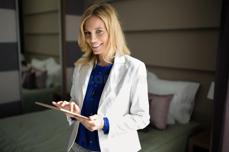 Portrait of attractive businesswoman in hotel room royalty free stock photo