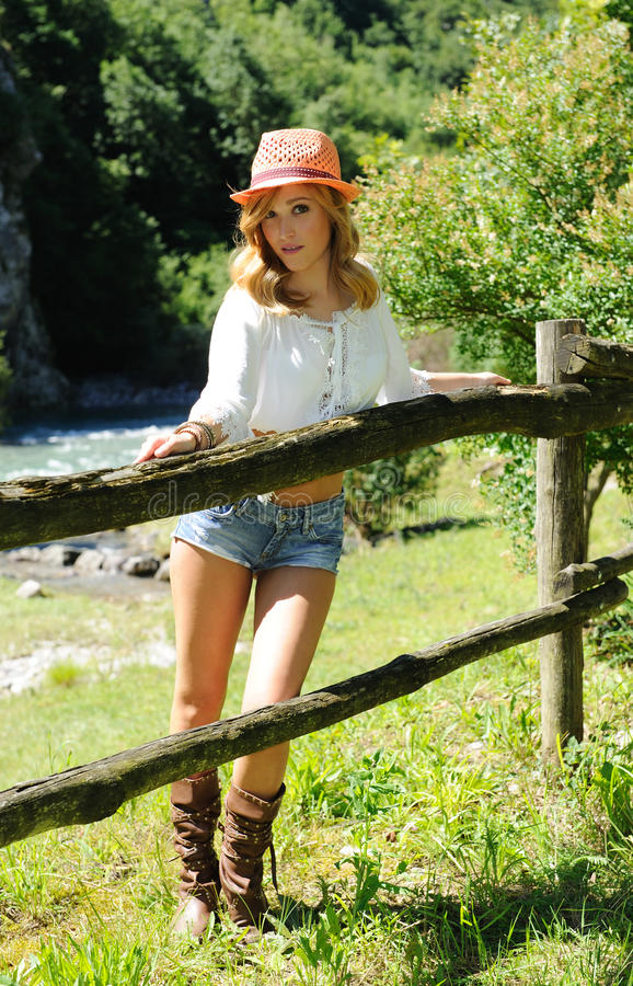 Portrait of attractive blonde on the ranch royalty free stock photo
