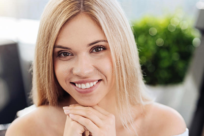 Portrait of an attractive blonde woman royalty free stock photo