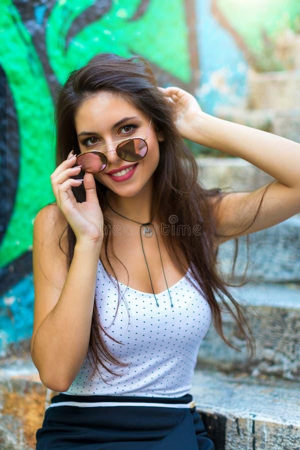 Portrait of an attractive, brunette, urban girl stock image