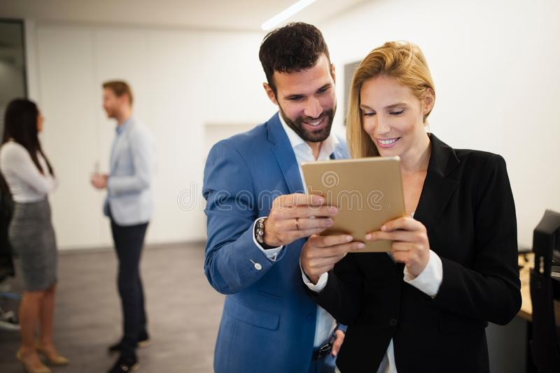 Portrait of attractive business partners using tablet stock image