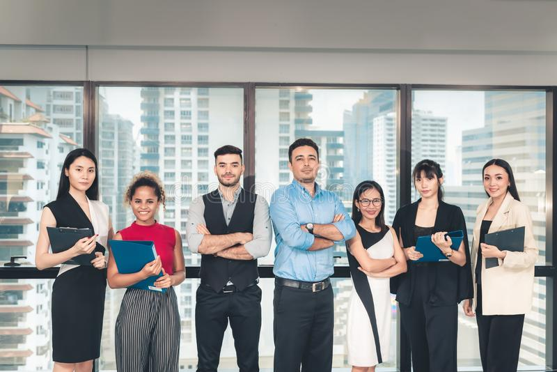 Portrait of Attractive Business People are Standing Beside Windows Frame in Modern Office, Confident Business Teamwork in Arms royalty free stock images