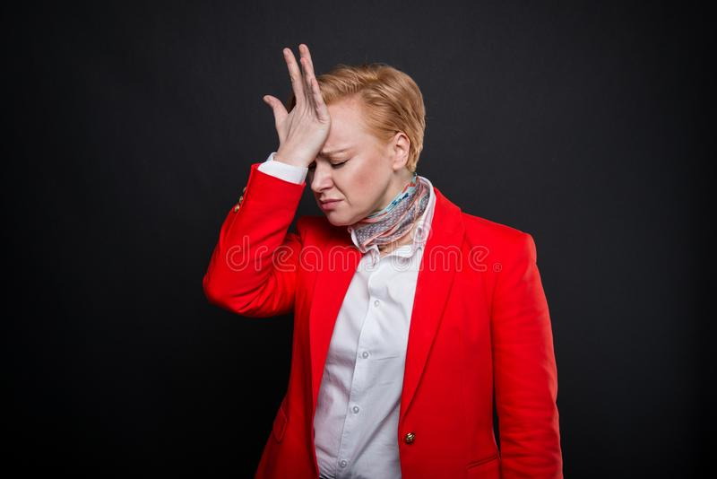 Portrait of attractive business woman face palm like hurting stock images