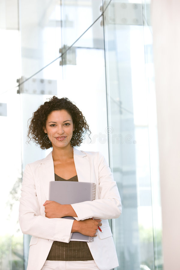 Portrait of attractive business woman holding fold royalty free stock images