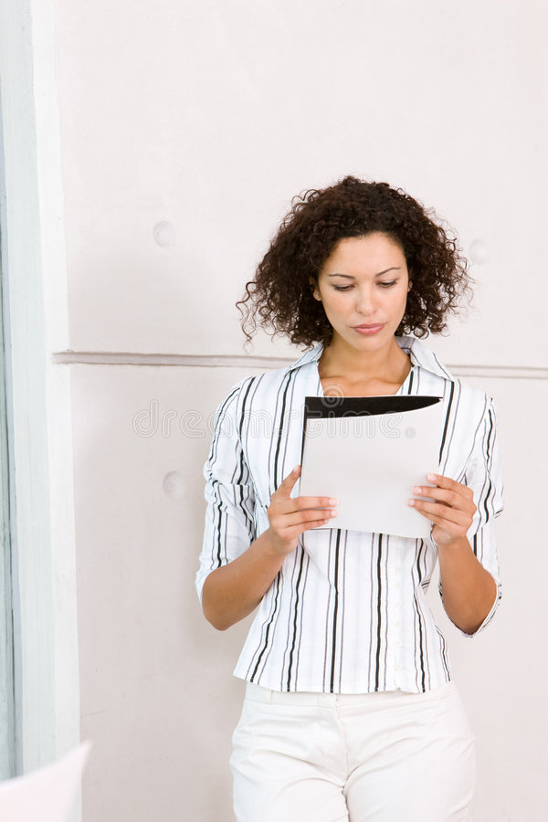Portrait of attractive business woman holding fold stock photography