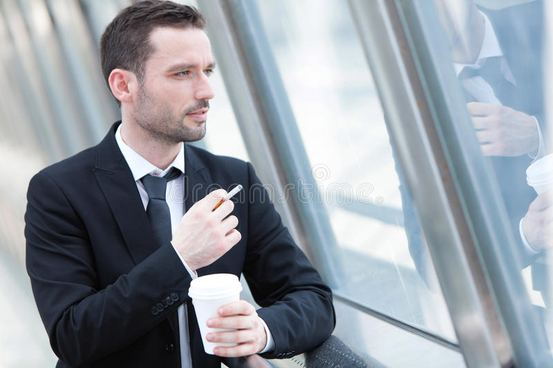 Portrait of an attractive businessman having a break stock images