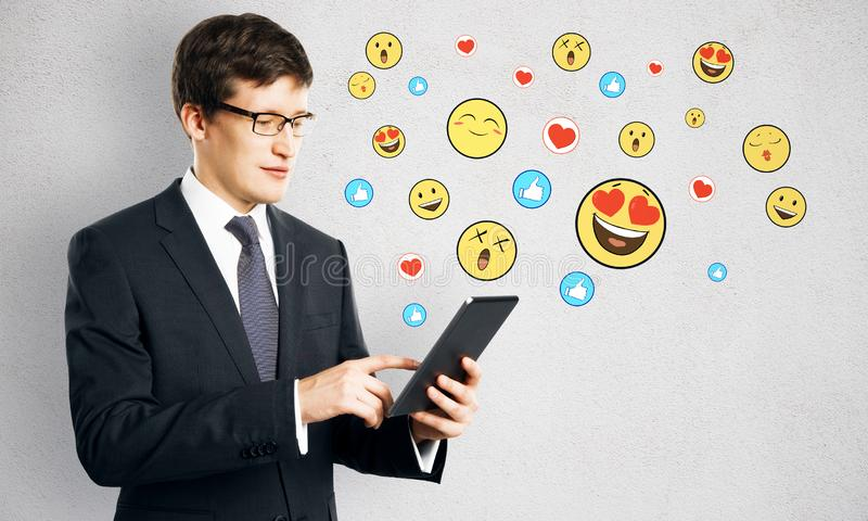 Portrait of attractive businessman with smileys stock photography