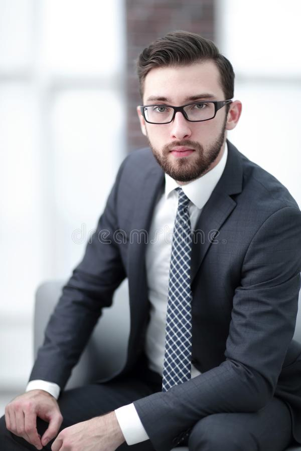 Portrait of an attractive businessman wearing glasses. Handsome unshaven young businessman wearing glasses and a suit in his office stock photos