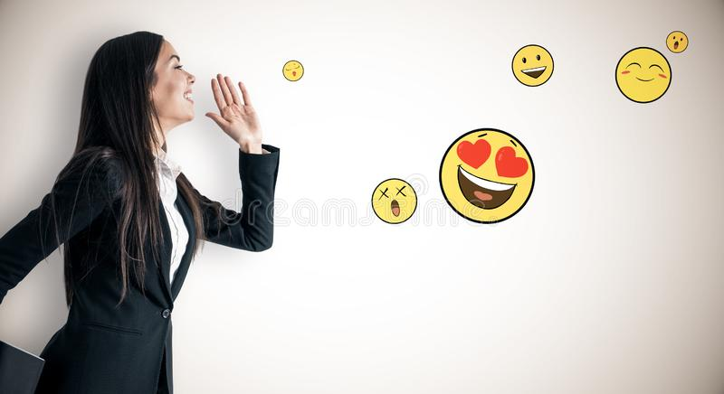 Portrait of attractive businesswoman with smileys royalty free stock photos