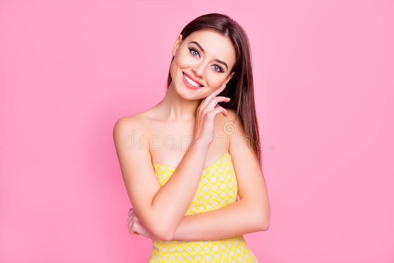 Portrait of attractive charming cute lovely tender gentle beautiful fashionable girl with long brown hair wearing yellow dotted d. Ress with naked shoulders royalty free stock photos