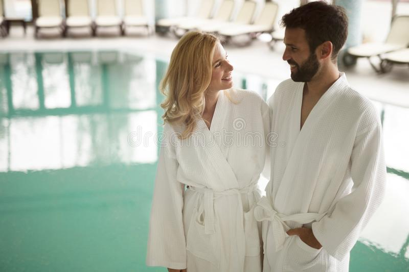 Portrait of attractive couple in spa center. Portrait of attractive cheerful couple in spa center royalty free stock images