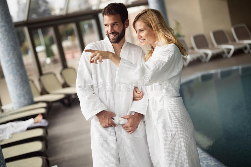 Portrait of attractive couple in spa center. Portrait of attractive cheerful couple in spa center royalty free stock image