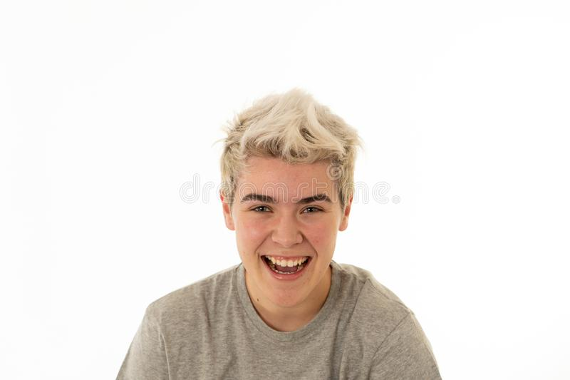 Portrait of attractive cheerful transgender young man with smiling happy face. Human expressions and emotions royalty free stock images