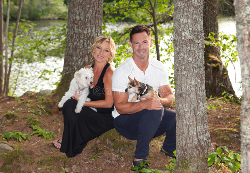 Portrait of an attractive couple with dogs royalty free stock images