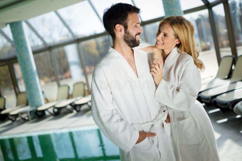 Portrait of attractive couple in spa center stock photo