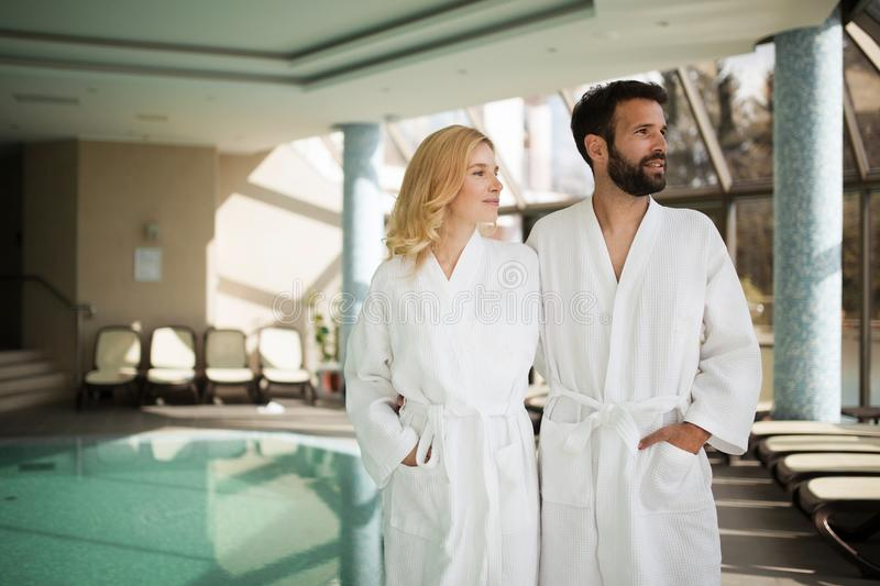 Portrait of attractive couple in spa center. Portrait of attractive cheerful couple in spa center stock photography