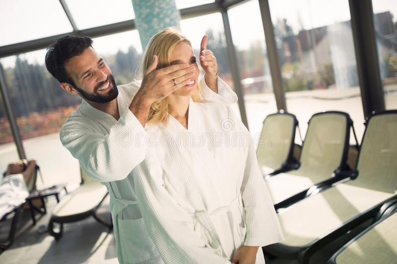Portrait of attractive couple in spa center. Portrait of attractive cheerful couple in spa center stock images