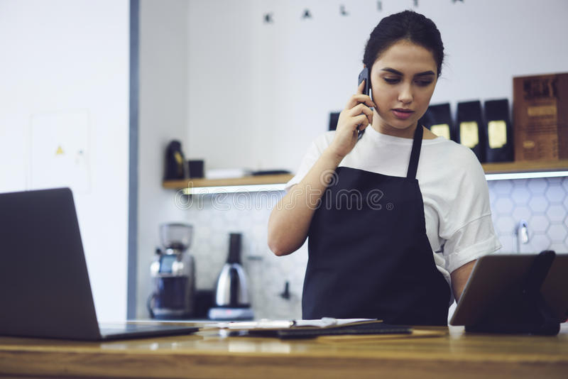 Portrait of attractive female barista working in cafeteria stock photo