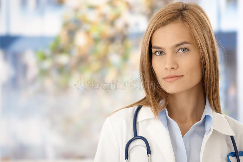 Portrait of attractive female doctor in hospital stock photo