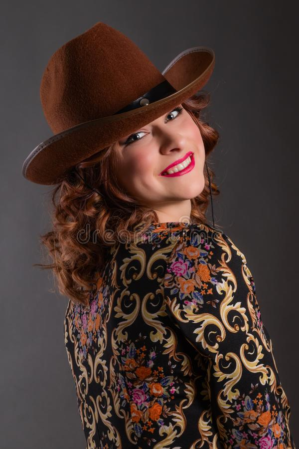 Portrait of attractive girl with angelic smile in cowboy hat stock photo