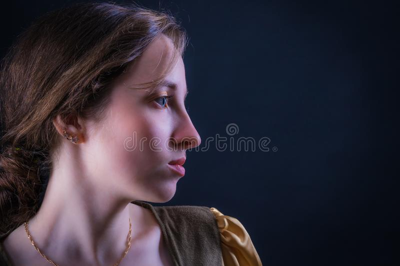 Portrait of an attractive girl in profile stock image
