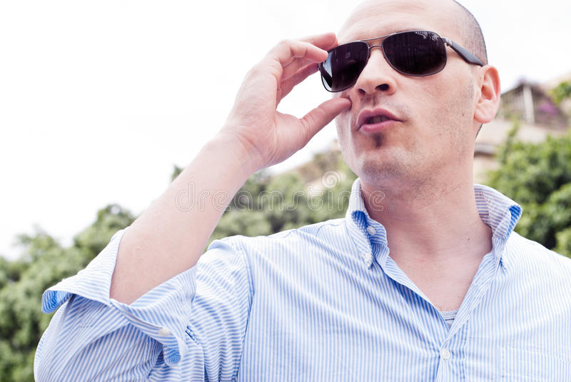 Portrait of a attractive gorgeous guy wearing sunglasses. Close up handsome man. Profile - portrait of a attractive gorgeous guy wearing sunglasses, outdoor-park royalty free stock images