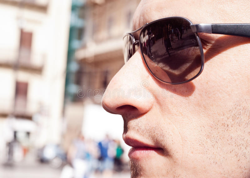 Portrait of a attractive gorgeous guy wearing sunglasses royalty free stock image