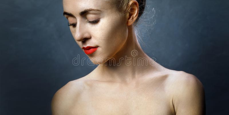 Portrait of Attractive Half-naked young Girl. Concept of Symbol of Female Beauty, Youth and Biohacking royalty free stock images