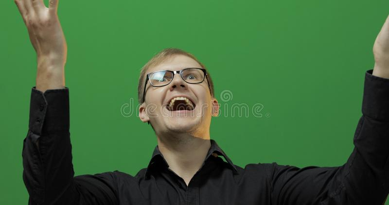 Portrait of attractive happy young man celebrate. Green screen. Chroma key. royalty free stock photos