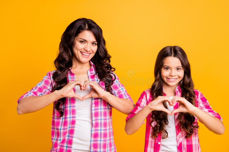 Portrait of attractive lovely nice mom kid feel satisfied glad enjoy show love trust tender gentle 8-march make heart. Hands dressed vivid stylish outfit royalty free stock images