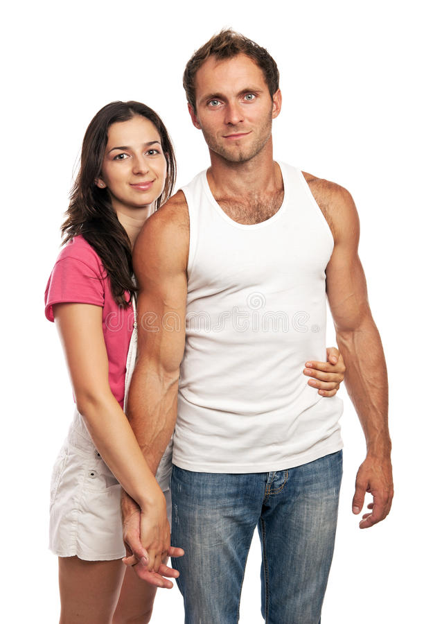 Portrait of an attractive loving couple looking at stock images