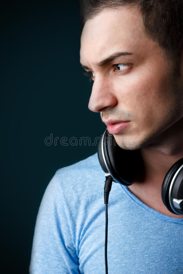 Portrait of attractive male deejay with headphones royalty free stock images