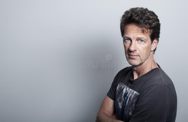 Portrait of an attractive man in front of a white background royalty free stock image