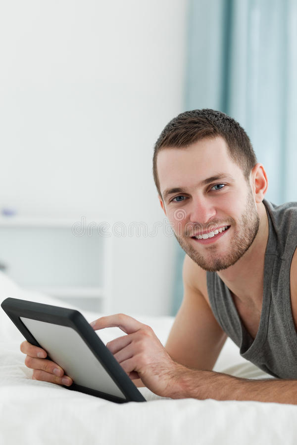 Download Portrait Of An Attractive Man Using A Tablet Computer Stock Image - Image of handsome, mobile: 22143909