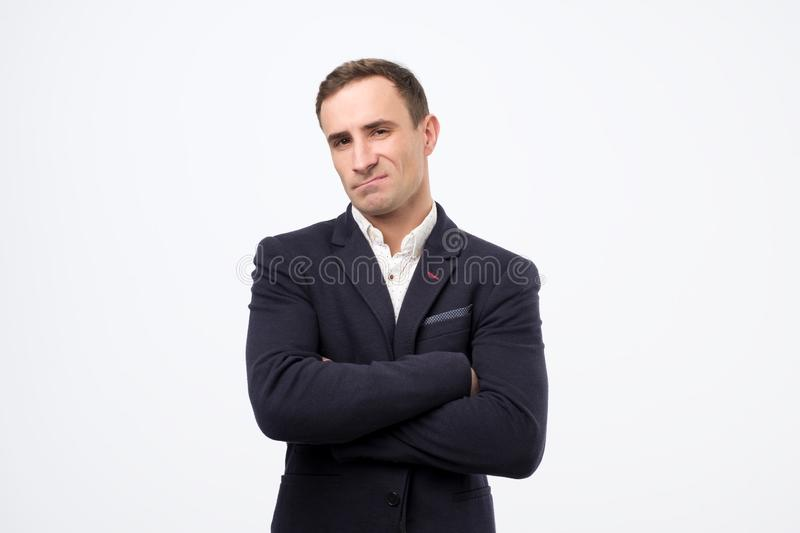 Portrait of a attractive mature italian man looking neutral serious. Portrait of a attractive mature italian man looking neutral serious in facial expressions stock photography