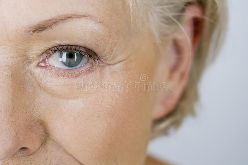 A portrait of an attractive senior woman, close-up of eye stock photo