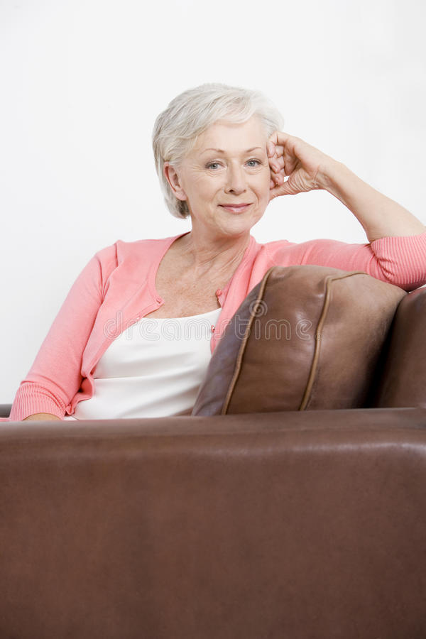 A portrait of an attractive senior woman, relaxing royalty free stock images