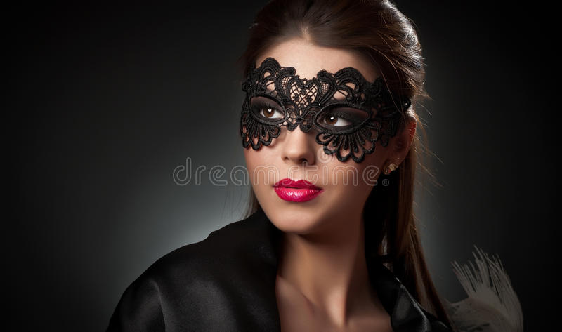 Download Portrait Of Attractive Sensual Young Woman With Mask. Young Attractive Brunette Lady Posing On Dark Background In Studio. Portrait Stock Photos - Image: 36419643