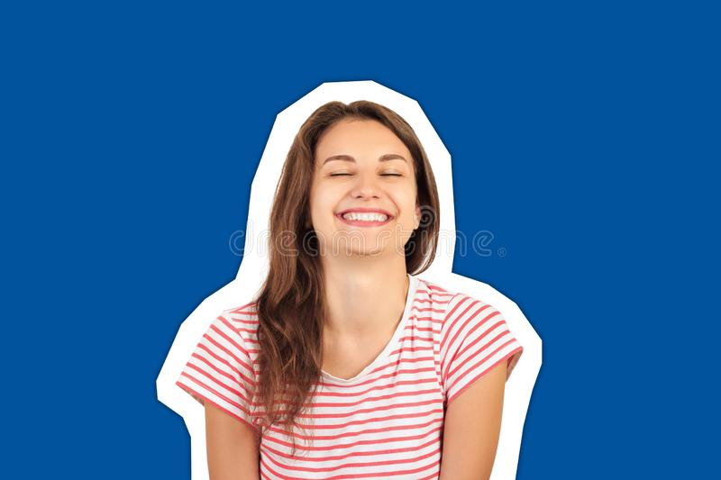 Portrait of an attractive smiling young brunette woman. emotional gloat girl Magazine collage style with trendy color background royalty free stock photos