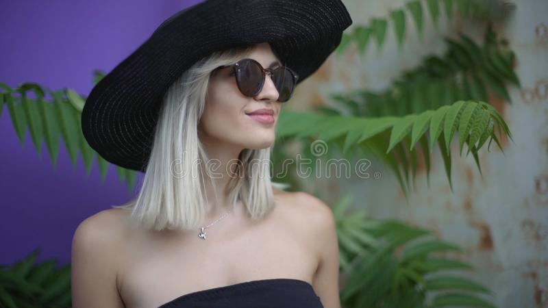 Portrait of an attractive smiling young woman in a hat. Stylish fashionably dressed royalty free stock images