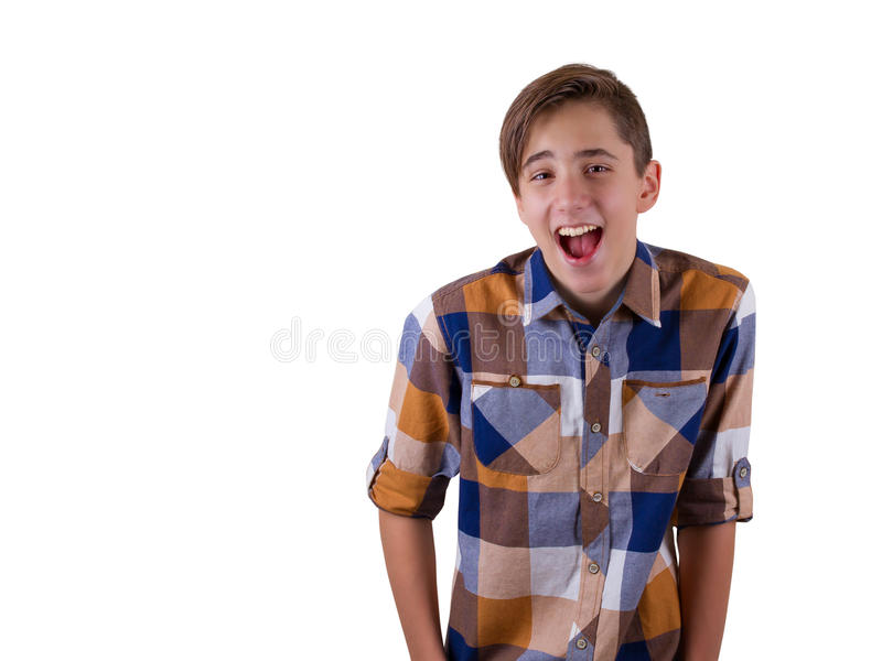 Portrait of attractive teen boy being photographed in a studio. Isolated on white background stock photography